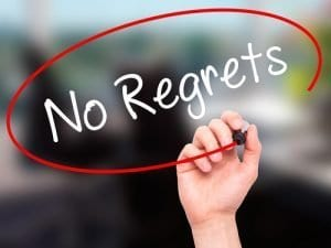 Man Hand writing No Regrets with black marker on visual screen. Isolated on background. Business, technology, internet concept. Stock Photo