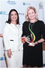 NAWBO President, Tanya Allen, presenting Katana the Top 10 Michigan Business Women Breakthrough Award